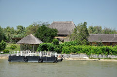 Traditional houses with thatched roof in the Danube delta Royalty Free Stock Photography