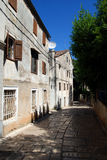 Traditional houses in Veli Losinj island in Croatia. Stone paved street in Veli Losinj island in Croatia Stock Photo
