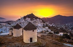 Traditional houses, wind mills and churches in Ios island, Cyclades. Royalty Free Stock Photo