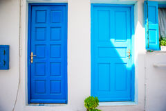 Traditional houses withe blue doors in the narrow streets of Mykonos, Greece. Royalty Free Stock Photography