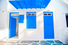 Traditional houses withe blue doors in the narrow streets of Mykonos, Greece. Royalty Free Stock Image