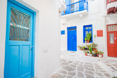 Traditional houses withe blue doors in the narrow streets of Mykonos, Greece. Stock Photography