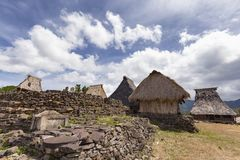 Stone wall and traditional houses royalty free stock photos