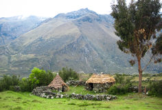 Traditional Housing in High-Elevation Peru. Stone huts with grass roofs and surrounding stone walls are commonly seen in high-elevation Peru, such as in this Stock Photography