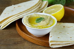Traditional hummus dip of chickpea with pita bread Stock Photos