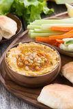 Traditional hummus with pita bread and vegetables, vertical Stock Photo