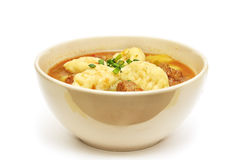 Traditional hungarian hot goulash soup. Isolated on white Stock Images