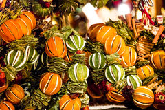 Traditional Hungarian ornaments. Dried fruit peel ornaments from Budapest Christmas market arranged in holiday boughs and wreaths Stock Image