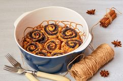Traditional Hungarian pastry for Thanksgiving and Christmas - poppy seed rolls with chocolate topping in the baking dish. Decorated with spices. Cinnamon buns stock image