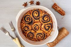 Traditional Hungarian pastry for Thanksgiving and Christmas - poppy seed sweet rolls in the baking dish decorated with spices. Traditional Hungarian pastry for stock photos
