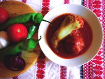 Taditional Hungarian stuffed pepper and meatball. Traditional hungarian stuffed pepper , filled with mincemeat and rice, with sweet tomato sauce Stock Images