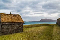 Traditional hut in the Faroe Islands with a green grass roof Stock Images