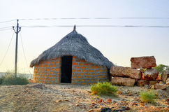 Traditional hut, Jaisalmer, Rajasthan, India. Primitive rounded house in the middle of the desert Royalty Free Stock Photos