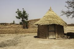 Traditional hut in a village of Burkina Faso West Africa. Traditional hut in a mosi village in the suburb of Ouagadougou Burkina Faso royalty free stock photos