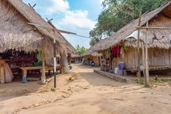 Traditional hut where the Long Neck Karen tribe lives in Chiang Rai, northern Thailand. Local houses at Long Neck Karen ethnic hill-tribe guarded village, Chiang royalty free stock photos