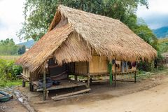 Traditional hut where the Long Neck Karen tribe lives in Chiang Rai, northern Thailand. Local houses at Long Neck Karen ethnic hill-tribe guarded village, Chiang stock image