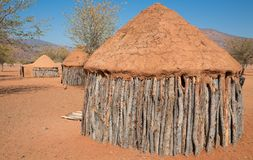Traditional huts of himba people Stock Photo