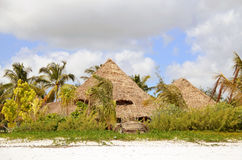 Traditional huts in tropical paradise Royalty Free Stock Photo