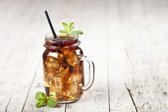Traditional Iced Tea With Lemon, Mint Leaves And Ice Cubes In Glass Jar On Rustic Wooden Table Background Royalty Free Stock Photo