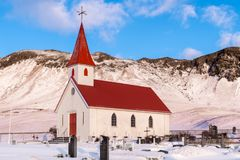 A traditional icelandic church stands proud at the foot of a small mountain, in southern Iceland. stock photography