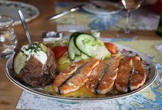 Traditional Icelandic dish with salmon steak and baked potatoes and vegetables stock image