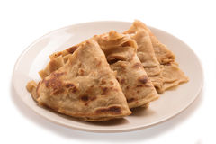 Traditional Indian Alu Paratha in a white plate. Royalty Free Stock Photography