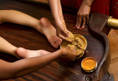 Traditional indian ayurvedic oil foot massage Stock Images