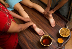 Traditional indian ayurvedic oil foot massage Royalty Free Stock Photo