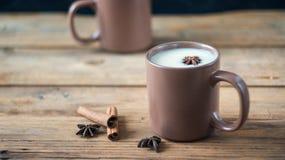 Traditional Indian black tea. Masala tea. Spiced tea with milk Stock Photos