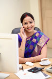 Traditional Indian business woman talking on mobile phone. In clinic Royalty Free Stock Photo