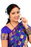 Traditional Indian business woman wearing headset Stock Photo