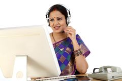 Traditional Indian business woman wearing headset Royalty Free Stock Photo