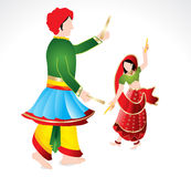 Traditional indian copule playing dandiya Stock Images