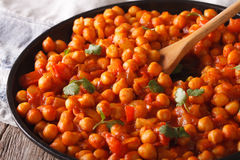Traditional Indian cuisine: Chana masala macro. Horizontal Royalty Free Stock Images