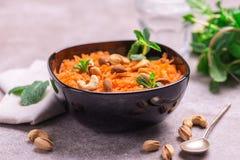 Indian carrot Gajar halwa. Copyspace, horizontal view, flatlay. Traditional Indian cuisine. Homemade carrot Gajar halwa on gray slate background. Copyspace stock photos