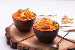 Indian carrot Gajar halwa. Copyspace, horizontal view. Traditional Indian cuisine. Homemade carrot Gajar halwa on wooden background. Copyspace, horizontal view Royalty Free Stock Image