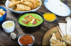 Palak paneer, Indian cooking, festive table, holi curry, indian,. Traditional Indian dish Palak paneer on the table with various treats, festive table, holi Stock Photos