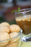 Traditional Indian drink and food. Several rolls in front of a drink Royalty Free Stock Image