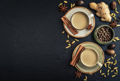 Masala chai tea. Traditional indian drink - masala chai tea milk tea with spices on black slate  background, top view Royalty Free Stock Photography