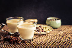 Masala chai tea. Traditional indian drink - masala chai tea milk tea with spices on rattan tray Royalty Free Stock Photos