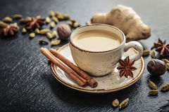 Traditional indian drink - masala tea. With spices on black stone  background Stock Images