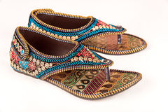 Traditional Indian ethnic sandals. Gorgeous pair of ethnic women footwear from India worn during wedding ceremony royalty free stock photo