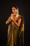 Traditional indian female greeting with dark background Royalty Free Stock Photos