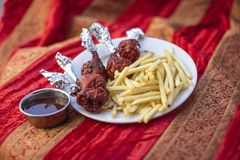Traditional indian food Chicken Lollypop. With fries Royalty Free Stock Photo