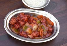 Traditional indian food Chilli Chicken. Traditional indian food - Chilli Chicken and pepper Stock Photos