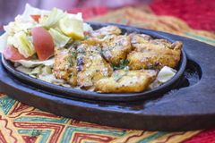 Traditional indian food fish tikka. With salad Royalty Free Stock Photography