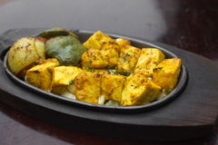 Traditional indian food paneer tikka. Grilled cheese stock photos
