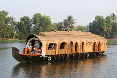 Traditional Indian houseboat cruising near Alleppey on Kerala ba Stock Photography