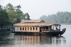 Traditional Indian houseboat cruising near Alleppey on Kerala ba Stock Images