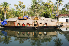 Traditional Indian houseboat cruising near Alleppey on Kerala ba Royalty Free Stock Image